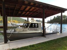 Boat with Flathead Lake Biological Station logo